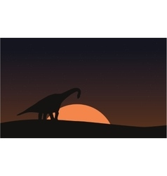 Silhouette of brachiosaurus on hill scenery vector image vector image