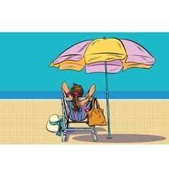 Girl in a deckchair on the beach vector