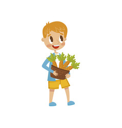 cute little boy holding basket full of carrots vector image