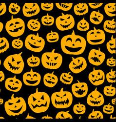 Seamless halloween pattern with pumpkin faces vector
