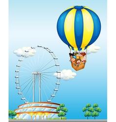 Children riding on giant balloon in sky vector