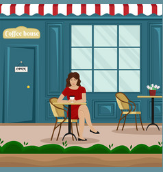 A girl with a cup of coffee at a table in a cafe vector