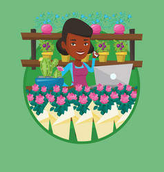 Owner of flower shop using phone and laptop vector