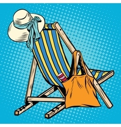 Deck chair with beach things women vector
