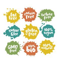 Eco vegan food labels set on color inkblots vector