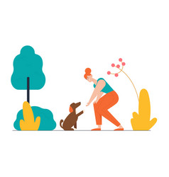 Happy woman playing with dog on street in park vector