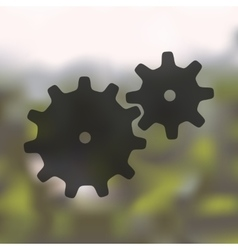 Cogwheel icon on blurred background vector