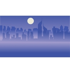 Silhouette of Dubai city with moon vector