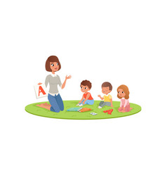 Teacher and little kids sitting on soft carpet and vector