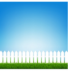 white fence with green grass and blue sky vector image