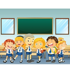 Students in uniform standing in classroom vector image