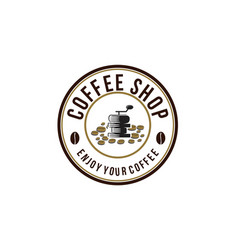 vintage grinder and pile of coffee bean logo vector image