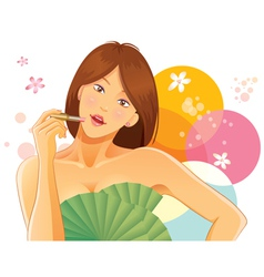 pretty girl using lipstick vector image
