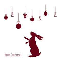 red silhouette hare with christmas balls vector image