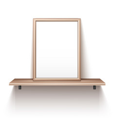 Empty photo frame standing on wooden shelf vector