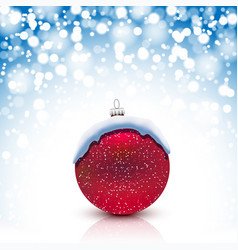 christmas red ball with snow cap on snowfall vector image