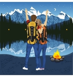 Young couple of hikers with hands up vector