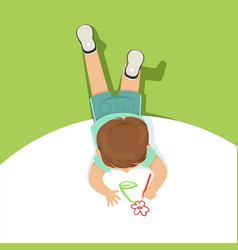 Little boy lying on his stomach and drawing flower vector