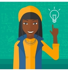 Woman pointing at light bulb vector image