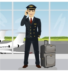 Young pilot talking on phone with luggage vector