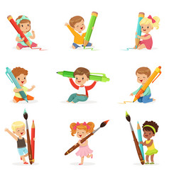 Cute young children holding big pencils pens and vector