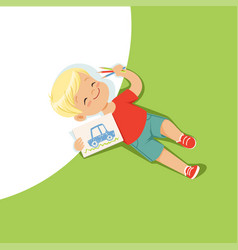 Little boy lying on his back and drawing with vector