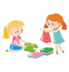 Two girls folding clothes vector