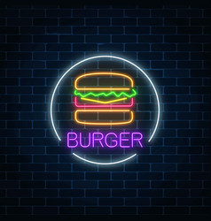 Neon glowing sign of burger in circle frame on a vector