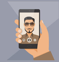 hipster bearded young man takes selfie using a vector image