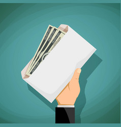 man holds in his hand an envelope with money vector image