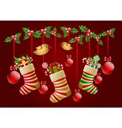 Hanging christmas socks with present and balls vector image