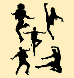 Happy young dancers silhouettes vector