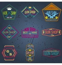 Pop art gun shop logotypes and badges set vector image