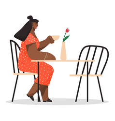 african american woman sitting on chair at a table vector image