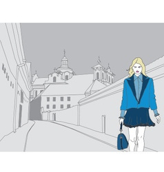 Fashion model on a gray old town background vector