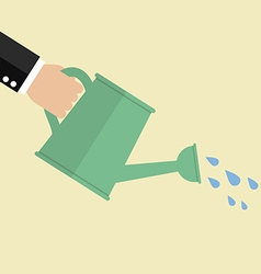 Hand holding watering can vector image vector image