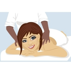 happy woman receiving back massage at salon spa vector image