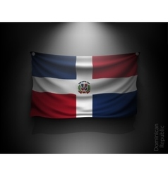 waving flag Dominican Republic on a dark wall vector image