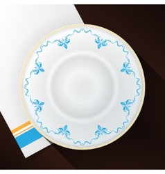 White plate with a blue pattern vector