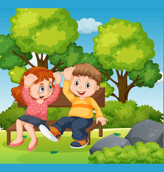 Boy and girl sitting in park together vector