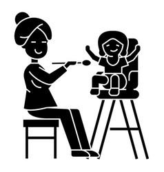 mother feeding child icon vector image