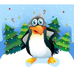 A penguin near the christmas trees vector image