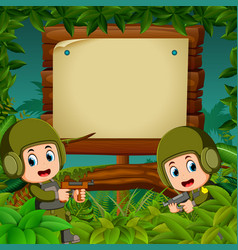 two soldiers with guns in the jungle vector image