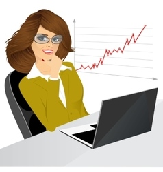 woman sitting with a laptop in the office vector image