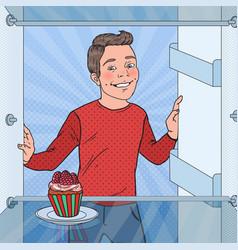 Pop art boy sees tasty cake in the fridge vector