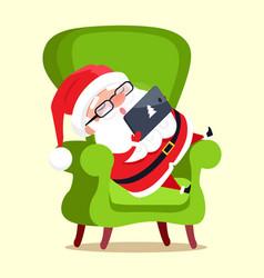 Santa claus with tablet icon vector