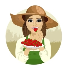 young woman tasting berry vector image