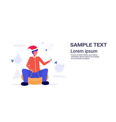 man in santa hat sledding on snow rubber tube vector image