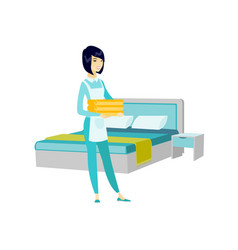 Asian housekeeping maid with stack of linen vector