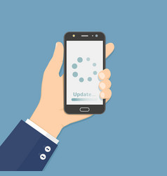 Hand holding smartphone with update loading vector